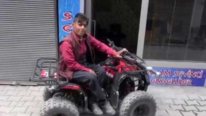 Pic shows: Irvul posing at camera with his ATV;