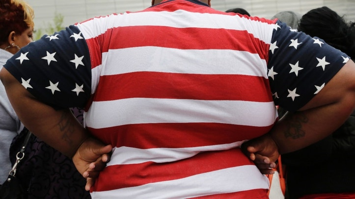 FILE - This May 8, 2014 file photo shows an overweight man in New York. Being too heavy may cost you your life _ literally. Scientists say overweight people die one year earlier than expected and that moderately obese people die up to three years prematurely in the biggest-ever analysis of such data, mostly from Europe and North America. (AP Photo/Mark Lennihan, File)