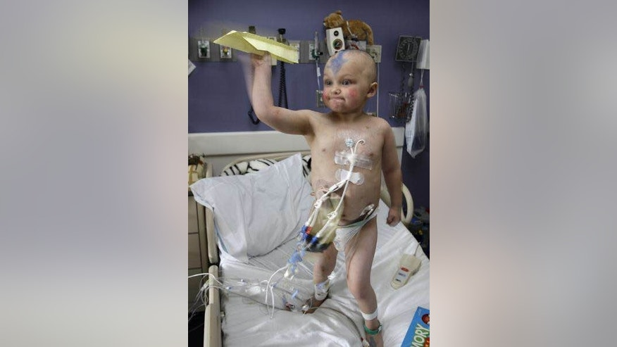 Nic Volker in his hospital bed in July 2010 shortly after he received a bone marrow transplant.
