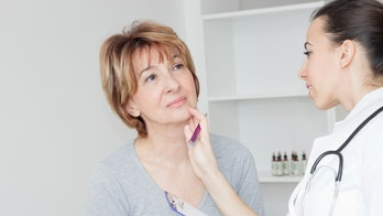thyroid_woman_doctor_throat_istock