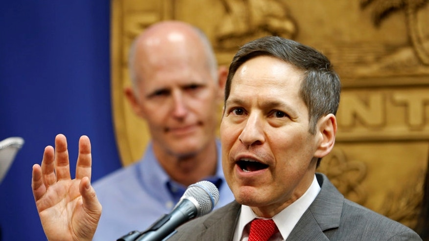 Dr. Tom Frieden, Director of Centers for Disease Control and Prevention, speaks as Florida Gov. Rick Scott looks on at a press conference about the Zika virus in Doral