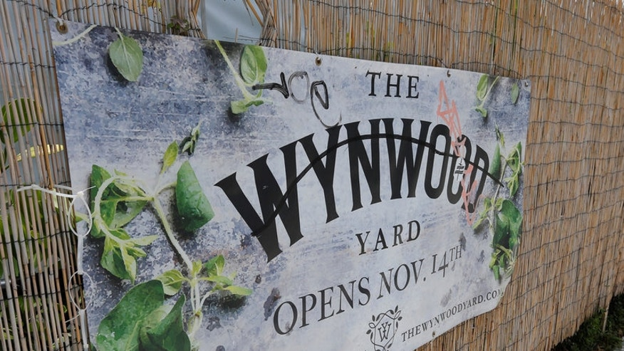 The sign for Wynwood Yard is seen in the Wynwood arts district of Miami