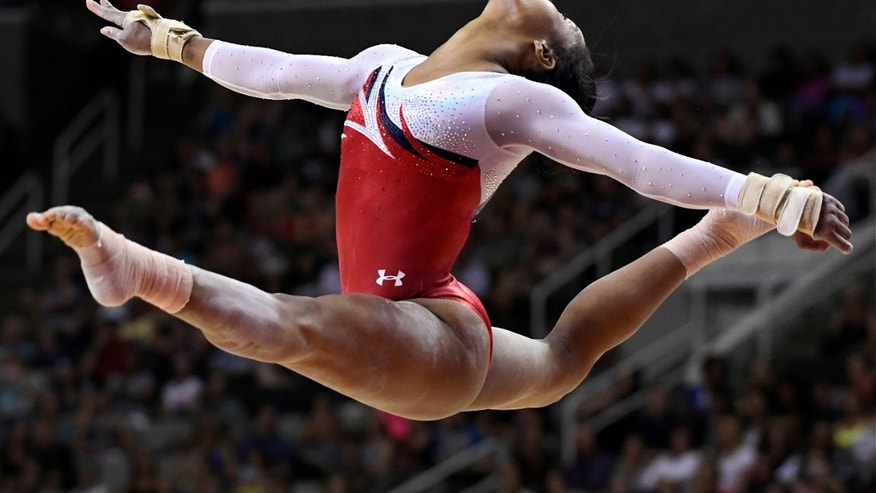 Jul 10, 2016; San Jose, CA, USA; Gabby Douglas during the floor exercise in the women's gymnastics U.S. Olympic team trials at SAP Center. Mandatory Credit: Robert Hanashiro-USA TODAY Sports - RTSHAD1