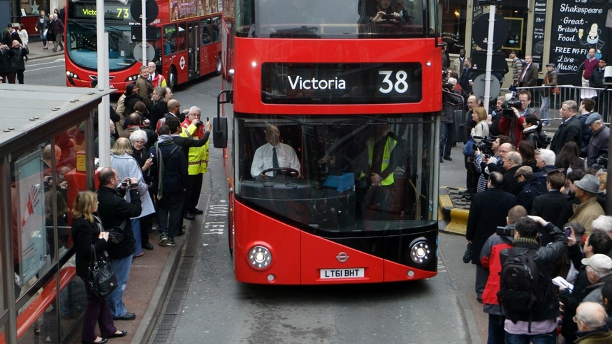 FILE - In this Monday, Feb. 27, 2012 file photo, a new Routemaster double decker bus arrives at Victoria bus station in London. Londoners will soon be able to get air quality reports when they check whether their bus is about to arrive. Mayor Sadiq Khan has ordered that 2,500 bus stop information signs display air quality alerts on high pollution days. The initiative, which begins Aug. 15, 2016 is part of Khan's crusade to clean up the air in the British capital. (AP Photo/Sang Tan, file)