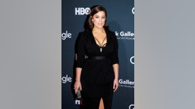 """Model Ashley Graham arrives at the Google, HBO and the Smithsonian's American Art Museum """"Celebration of Creativity"""" cocktail party to celebrate the White House Correspondents' Association dinner weekend in Washington, U.S., April 29, 2016. REUTERS/Joshua Roberts - RTX2C80B"""