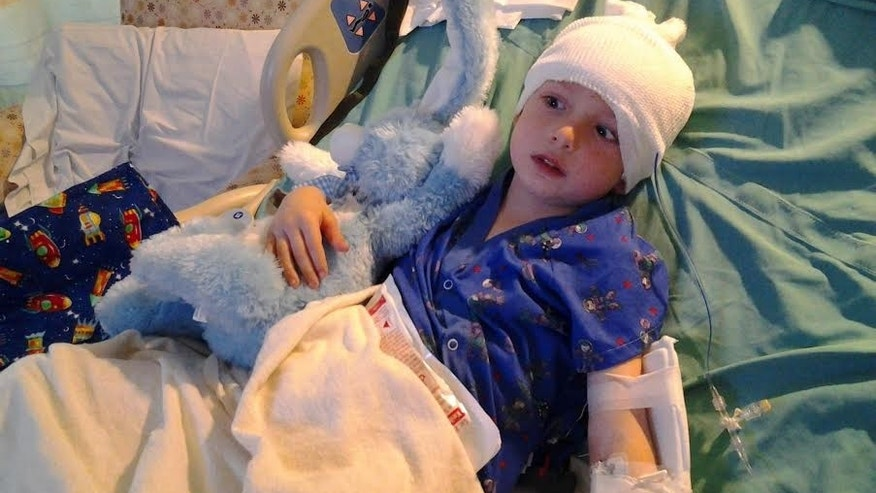 Gavin Pierson in the hospital at age 5 on Easter Day 2012, the day after he received his diagnosis and underwent emergency brain surgery to place a drain in his ventricles.