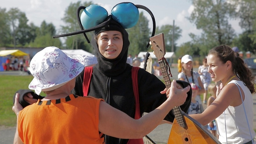 Aug. 14 2016: In this frame grab provided by the APTN a woman dressed as a mosquito enjoyes with others a sunny SUnday during the Russia Mosquito Festival in the town of Berezniki.