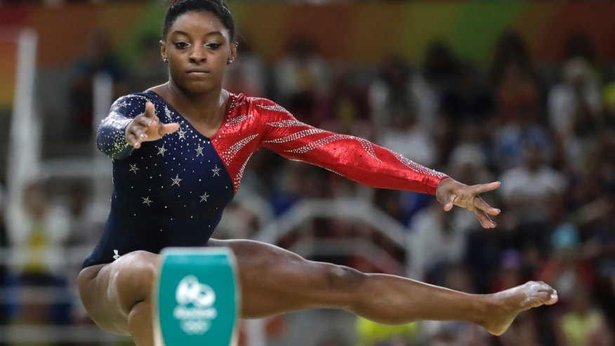 United States' Simone Biles performs on the balance beam during the artistic gymnastics women's qualification at the 2016 Summer Olympics in Rio de Janeiro, Brazil, Sunday, Aug. 7, 2016.