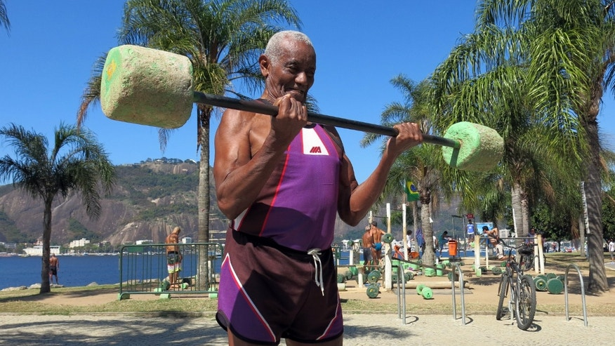 Jose Rebamar, 75, lifts weights at an outside gym in Rio de Janeiro, Brazil, Sunday, Aug. 14, 2016.