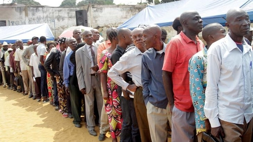 Congolese civilians queue at a soccer pitch to be vaccinated during an emergency campaign of vaccination against yellow fever in Kisenso district, of the DRC's capital Kinshasa