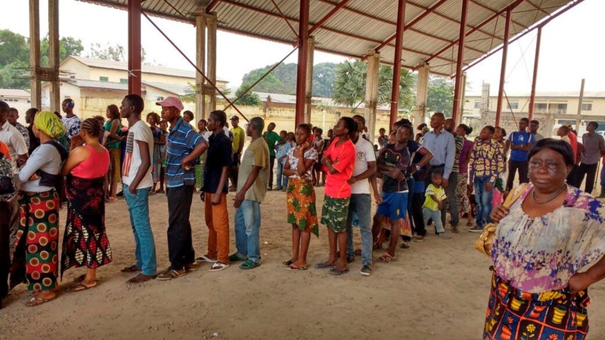 Congolese people queue to receive vaccination against yellow fever in Gombe district, of the Democratic Republic of Congo's capital Kinshasa