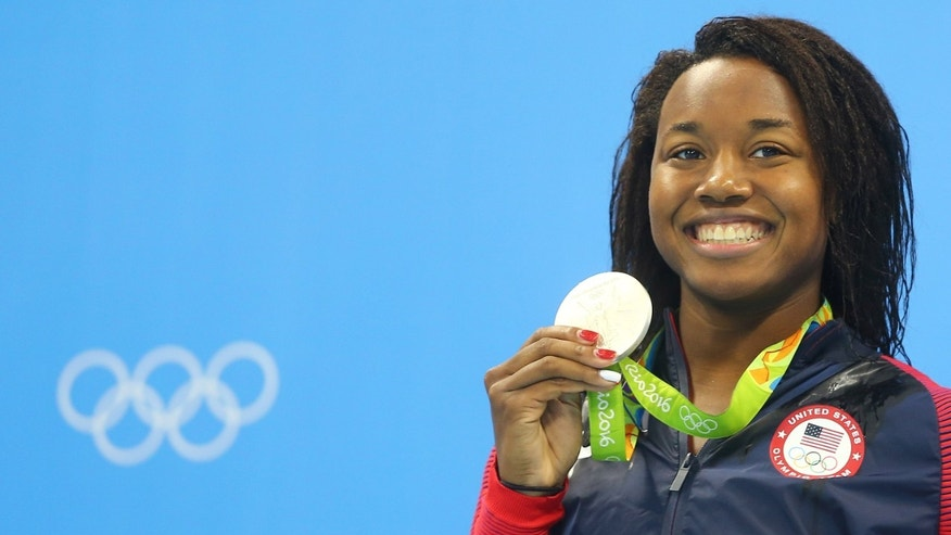 Simone Manuel (USA) of USA poses with her medal.