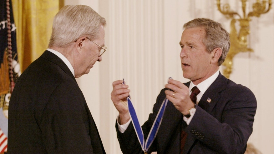 Then U.S. President George W. Bush presents D.A. Henderson, who is credited with eradicating smallpox worldwide, with the Presidential Medal of Freedom at the White House, July 9, 2002.