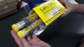 FILE - In this July 8, 2016 file photo, a package of EpiPens, an epinephrine autoinjector for the treatment of allergic reactions is displayed in Sacramento, Calif. Lawmakers are demanding more information on why the price for live-saving EpiPens has skyrocketed. EpiPens are used largely by children to ward off potentially fatal allergic reactions, and its price has surged in recent years. A two-dose package cost less than $60 nine years ago. The cost is now closer to $400.
