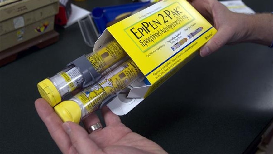 In this July 8, 2016 file photo, a package of EpiPens, an epinephrine autoinjector for the treatment of allergic reactions is displayed in Sacramento, Calif. Lawmakers are demanding more information on why the price for live-saving EpiPens has skyrocketed. EpiPens are used largely by children to ward off potentially fatal allergic reactions, and its price has surged in recent years. A two-dose package cost less than $60 nine years ago. The cost is now closer to $400.