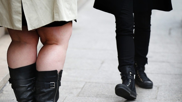 The legs of women are pictured as they walk along a street in Paris, France, October 14, 2015.  Worldwide obesity has more than doubled since 1980, Worldwide Health Organization said in its January report. In 2014, more than 1.9 billion adults, 18 years and older, were overweight. Of these over 600 million were obese.  REUTERS/Jacky Naegelen - RTS4G0V
