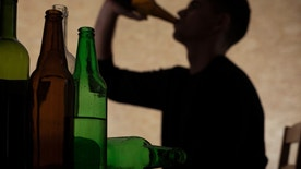 Alcoholism among young people - teenager drinking beer