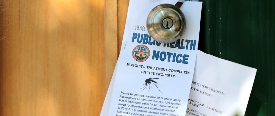 Notices given to homeowners as San Diego County officials hand spray a two block area to help prevent the mosquito-borne transmission of the Zika virus in San Diego, California, U.S. August 19, 2016.  REUTERS/Earnie Grafton - RTX2M4U7
