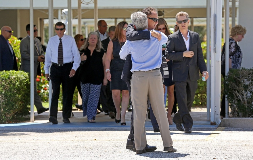 Mourners exit the Parker Playhouse following a memorial service for John Stevens and his wife Michelle Mishcon, Friday, Aug. 19, 2016, in Fort Lauderdale, Fla. A Florida sheriff's office said Friday, that Austin Harrouff, 19, will be charged with two counts of first-degree murder in the couples death, raising the possibility of the death penalty. (Mike Stocker/South Florida Sun-Sentinel via AP)