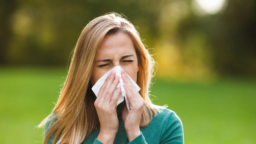 woman with allergies istock