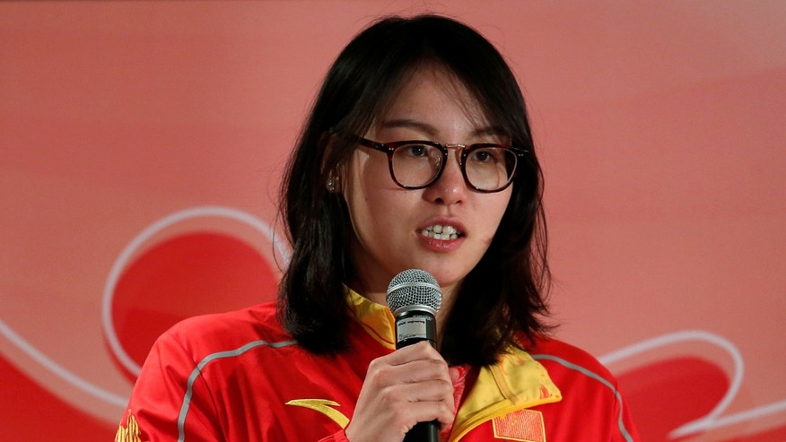 Chinese swimmer Fu Yuanhui speaks during a news conference as Chinese Olympic medallists visit Hong Kong, China August 27, 2016. REUTERS/Bobby Yip - RTX2N8VA