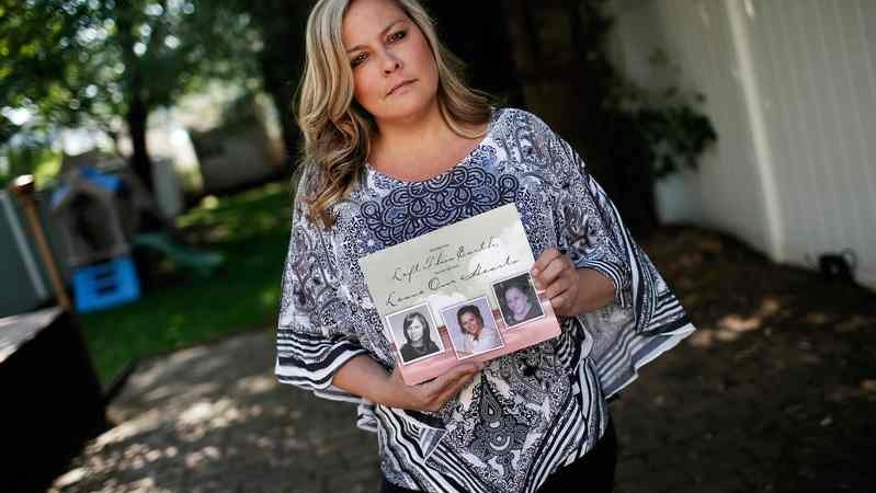 Monica Berckes, poses with the funeral program of her late mother Marianne Rumsey who died several months after contracting MRSA during heart surgery, at her home in Secaucus