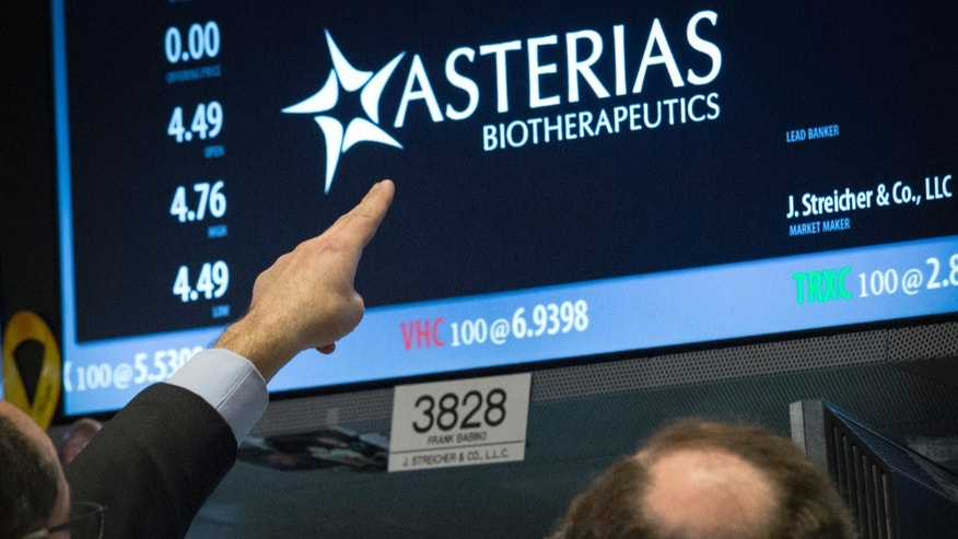 Traders gather at the post that trades Asterias Biotherapeutics, Inc. on the floor of the New York Stock Exchange March 5, 2015. REUTERS/Brendan McDermid (UNITED STATES - Tags: BUSINESS SCIENCE TECHNOLOGY) - RTR4S7OF