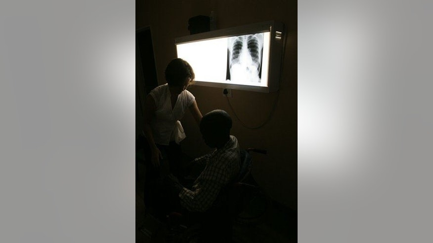 File photo of a radiologist and a patient.