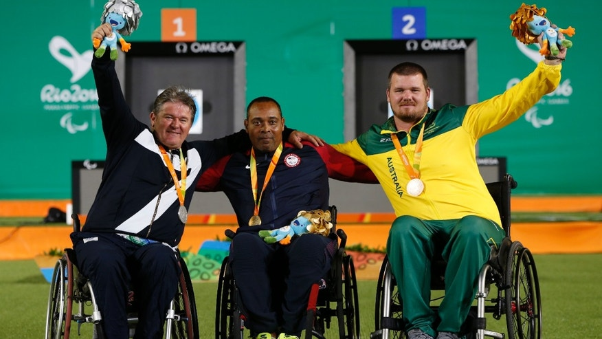 From left, Luigi Alberto Simonelli (ITA) of Italy, Andre Shelby (USA) of the United States and Jonathon Milne (AUS) of Australia pose during the medal ceremony.