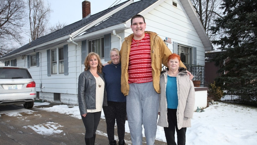 Broc Brown with (L-R) his aunt Stacy Snyder, his mother Darci Moss Elliot and his grandmother Joy Moss at his grandmother's house on January 22, 2016 in Jackson, Michigan.