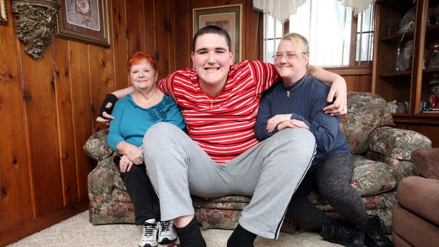 Broc Brown with (L-R) his grandmother Joy Moss and his mother Darci Moss Elliot at his grandmother's house on January 22, 2016 in Jackson, Michigan.