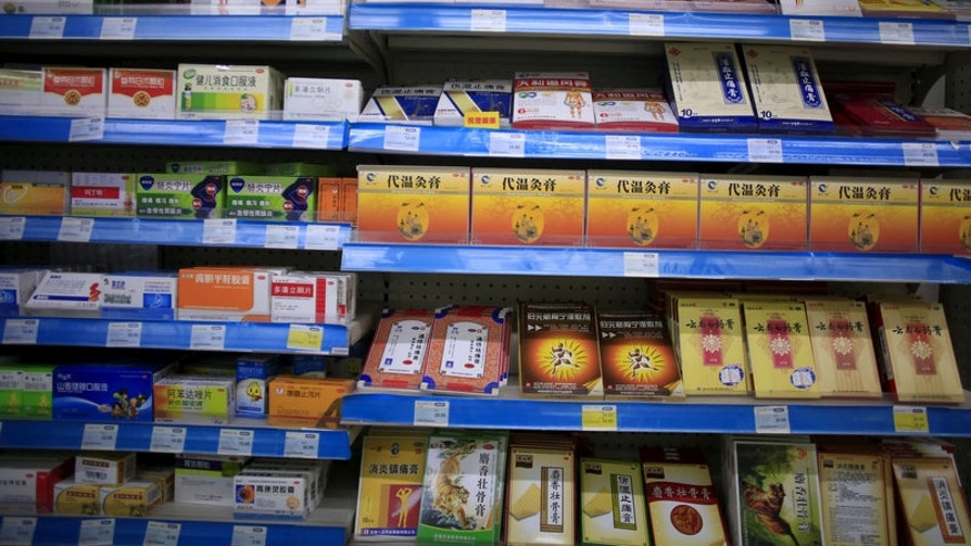 Shelves displaying medicines are seen at a pharmacy in Shanghai