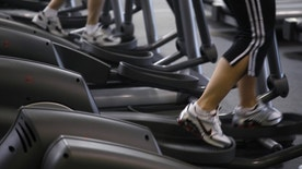 Clients work out on machines at the Bally Total Fitness facility in Arvada