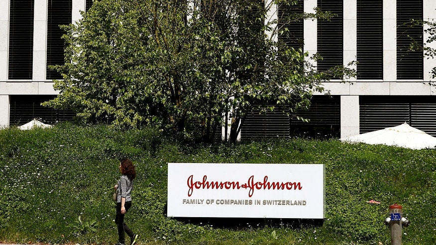 The logo of health care company Johnson & Johnson is seen in front of an office building in Zug, Switzerland July 20, 2016.