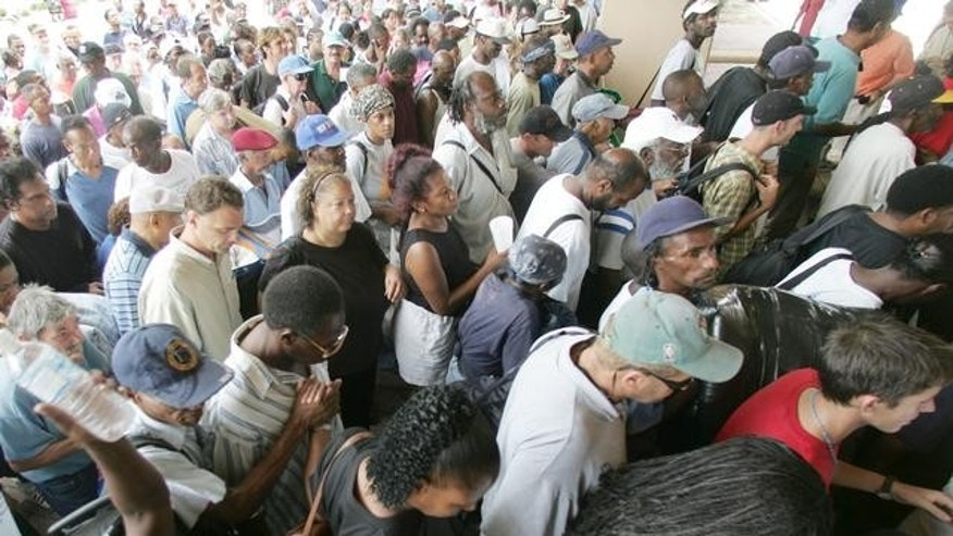 Hundreds of residents funnel into the Louisiana Superdome in New Orleans on Sunday, Aug. 28, 2005.