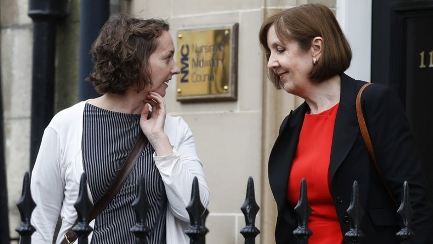 Pauline Cafferkey (L) a nurse who survived Ebola who was cleared of misconduct charges by the Nursing and Midwifery Council leaves the hearing in Edinburgh, Scotland