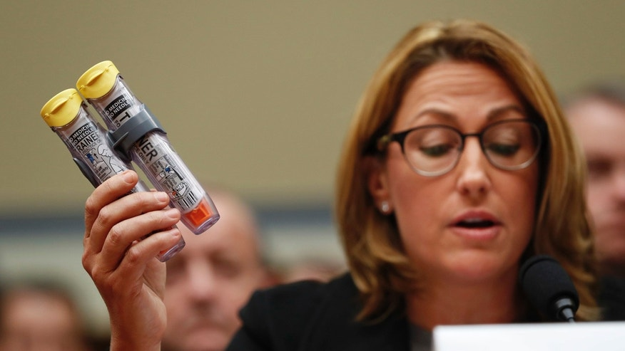 Sept. 21, 2016: Mylan CEO Heather Bresch holds up EpiPens while testifying on Capitol Hill in Washington, before the House Oversight Committee hearing on EpiPen price increases.