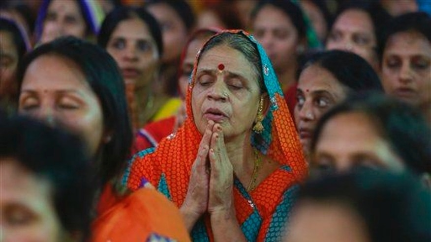 A member of India's Jain community offers prayers during a protest in Mumbai, India, on Aug. 24, 2015. The Jains protested against a high court order banning the religious practice of fasting until death.