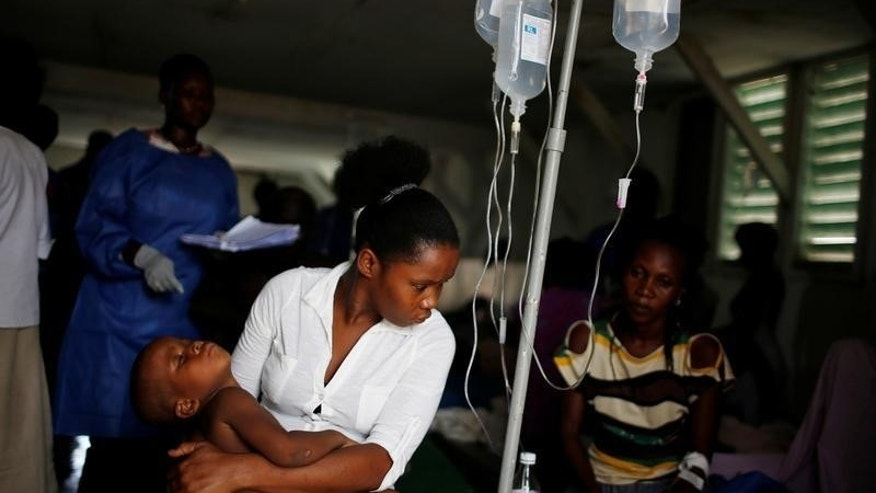 People are treated at the cholera treatment center at the hospital after Hurricane Matthew passes in Jeremie