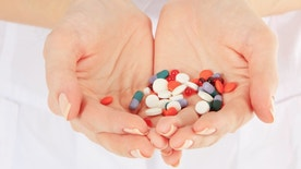 Close-up of doctor holding a pills in the hands