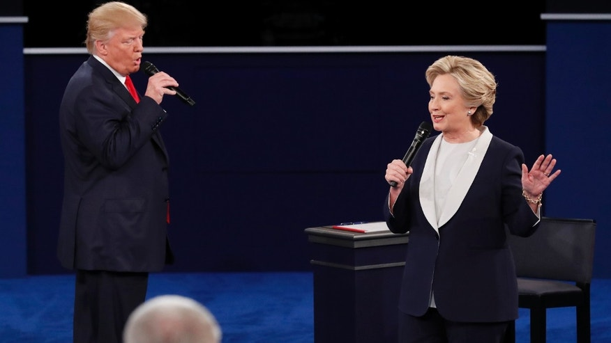 Republican U.S. presidential nominee Donald Trump and Democratic U.S. presidential nominee Hillary Clinton speak during their presidential town hall debate at Washington University in St. Louis, Missouri, U.S., October 9, 2016.