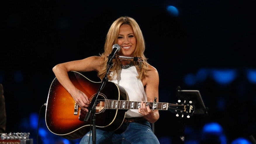 "Musician Sheryl Crow performs ""Boots of Spanish Leather"" at the 2015 MusiCares Person of the Year tribute honoring Bob Dylan in Los Angeles, California February 6, 2015."