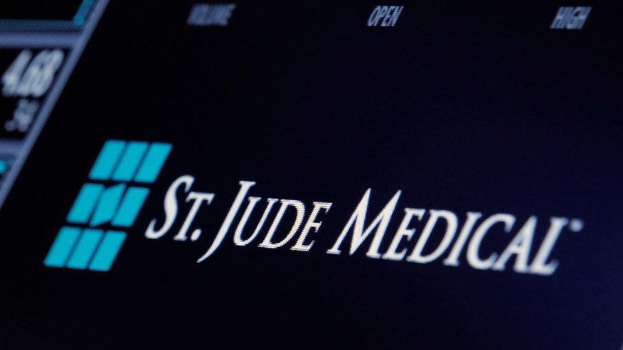 The ticker and trading information for St. Jude Medical is displayed where the stock is traded on the floor of the New York Stock Exchange (NYSE) in New York City, U.S., April 28, 2016.