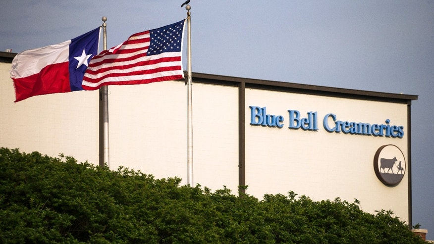 "FILE - In thus April 23, 2015 file photo, flags flutter in the breeze outside of the Blue Bell Creameries in Brenham, Texas. A supplier of cookie dough that Blue Bell Creameries is blaming for a possible listeria contamination of some of its ice cream products says its product tested negative for the pathogen before being sent to the Texas-based company. In a statement Thursday, Sept. 22, 2016, Iowa-based Aspen Hills said the ""positive listeria results were obtained by Blue Bell only after our product had been in their control for almost two months."" (Smiley N. Pool/The Dallas Morning News via AP, File)"