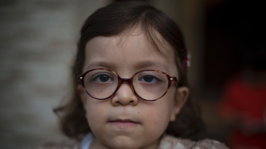 Pakistan's Maria, 6, who is suffering from MPS, poses for a picture in Rawalpindi, Pakistan.