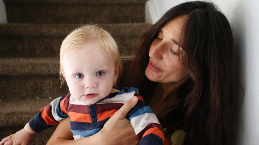 Oct. 20, 2016: In this photo, vegan mother Fulvia Serra holds her 1-year-old son Sebastiano.