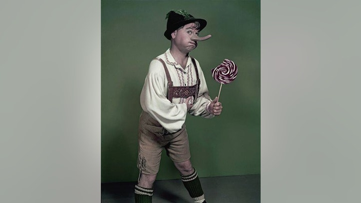 "Actor Mickey Rooney portrays ""Pinnochio,"" in this September 1957, file photo."