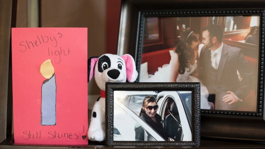 Seen in an Oct. 18, 2016 photo, the Canal Winchester, Ohio home of Craig Amick, 57, and Laurie Amick, 53, is filled with photos of their daughter, Shelby Slagle, who died, June 26, 2015 to a fungal infection at UPMC Presbyterian in Pittsburgh. Slagle, who was born with a heart defect, successfully received a heart transplant at UMPC Presbyterian but contracted a fungal infection and died 55 days later.  (Andrew Russell/Pittsburgh Tribune-Review via AP)