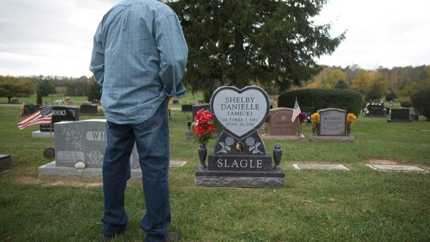 In a Tuesday, Oct. 18, 2016 photo, Craig Amick, 57, of Canal Winchester, Ohio, stands at the gravesite in Canal Winchester, Ohio,  of his daughter, Shelby Slagle, who died, June 26, 2015 of a fungal infection at UPMC Presbyterian in Pittsburgh. Slagle, who was born with a heart defect, successfully received a heart transplant at UMPC Presbyterian but contracted a fungal infection and died 55 days later.  (Andrew Russell/Pittsburgh Tribune-Review via AP)