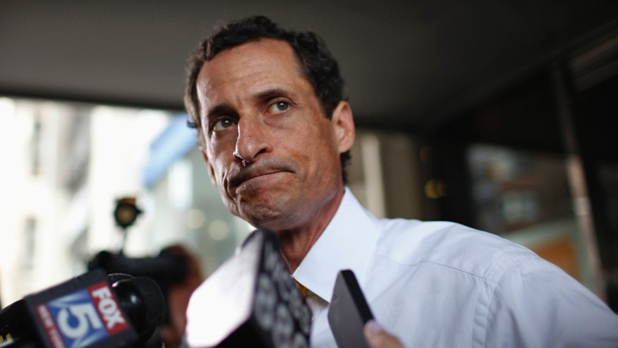 July 24, 2013: Anthony Weiner stops to speak to the media after admitting sending sexually explicit messages and photos to women even after the online sex chat scandal that cost him his congressional seat.